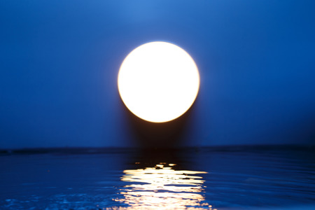 horizon over water: Full Moon Stock Photo