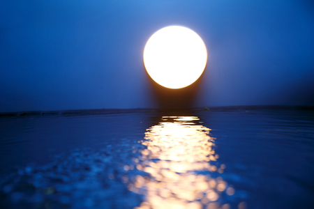 horizon over water: Mid Autumn Moon Stock Photo