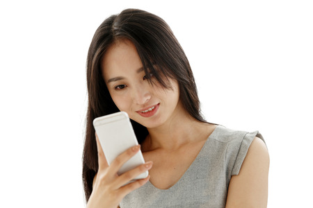 young women: Young women look at mobile phones Stock Photo