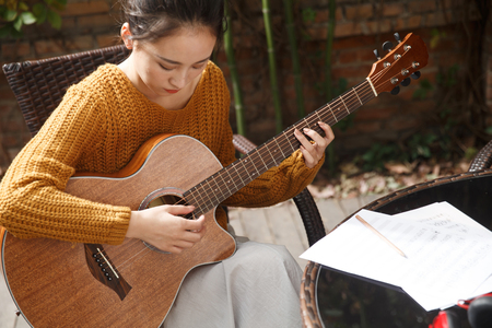 Young woman playing guitar