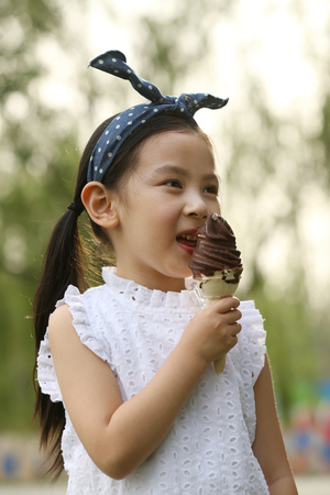 The little girl eats ice cream Stock Photo