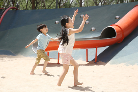 Children are playing in the sand