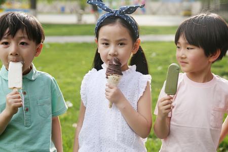 Children eat ice cream Stock Photo