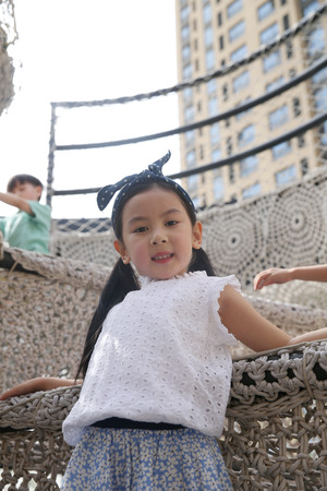 The little girl is playing outside Stock Photo
