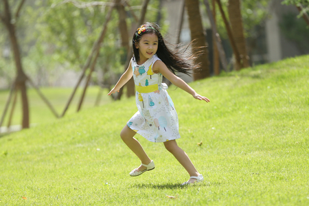 The little girl was playing outdoors