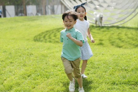 Children are playing on the grass Stock Photo