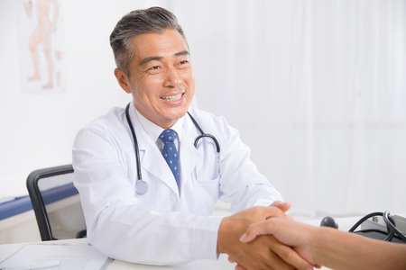 Doctors and patients to shake hands Stock Photo