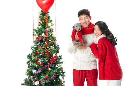 Young couple with a dog celebrating Christmas