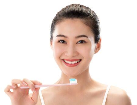 Young women to brush teeth