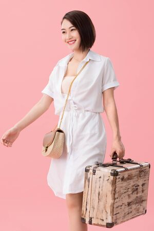 Young women bring luggage to travel Stock Photo