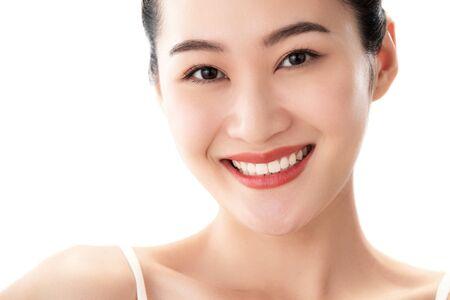 Young women applying makeup 写真素材