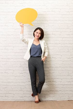 Happy young woman holding yellow card