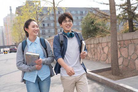 College students walking along the campus Banco de Imagens