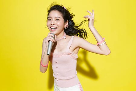 The young woman singing Stock Photo
