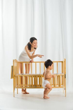 Mother playing with baby at room