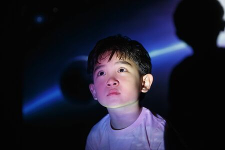 Kindergarten kids watching video Stock Photo