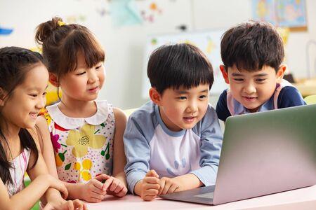 The kindergarten children watch video Banco de Imagens