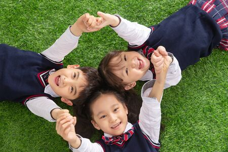 The pupils lying on the grass