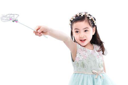Niña linda con varita mágica Foto de archivo