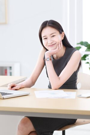 Business women smiling in office