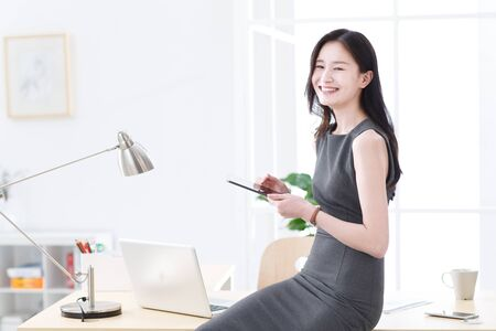 Business women using tablet in office Stock Photo