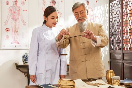 old and young doctor of traditional Chinese medicine