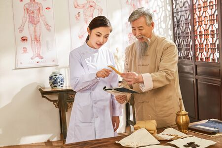 Old and young doctor of traditional Chinese medicine Chinese study medicine ingredient