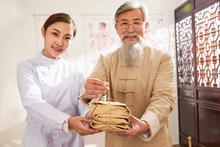 old and the young doctor of traditional Chinese medicine