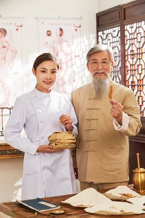 young and old doctor of traditional Chinese medicine Stock Photo