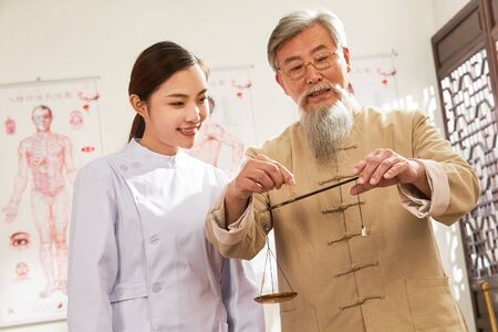 chinese man measuring the traditional Chinese medicine