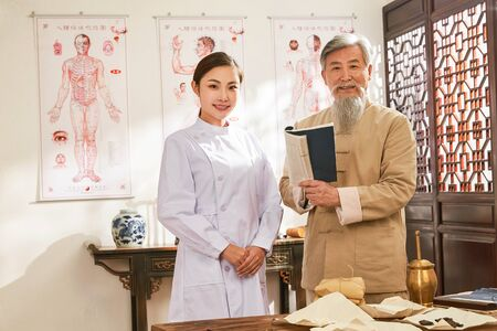 A portrait of the old and the young doctor of traditional Chinese medicine