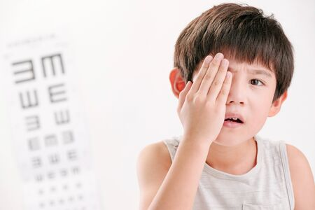 The little boy with eye test Stock Photo