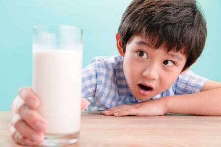The little boy with a glass of milk