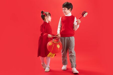 Two children with red lanterns