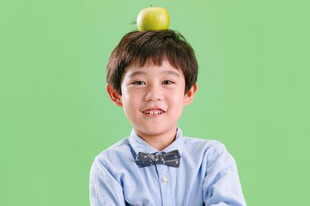 The little boy with an apple on his head
