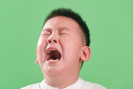 The sad little boy crying Stockfoto