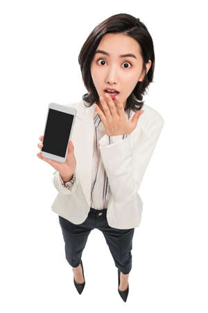 Young female white-collar workers with mobile phones