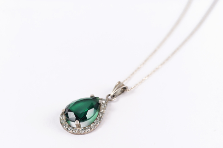 pendant of white gold and emerald Stock fotó