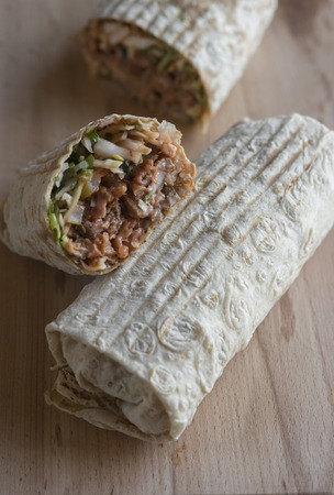 traditional oriental sandwich with meat, onion and herbs Stock Photo