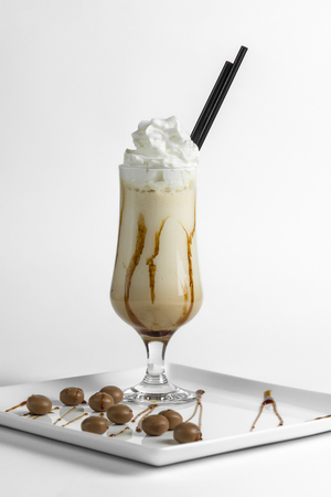 Ice coffee on a white plate on a white background Stock Photo
