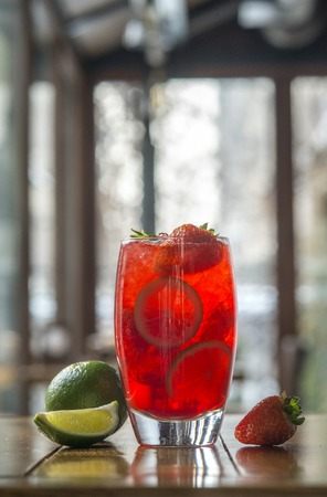fresh strawberry lemonade with citrus on wooden table