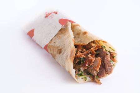 Tasty shawarma sandwich isolated on white