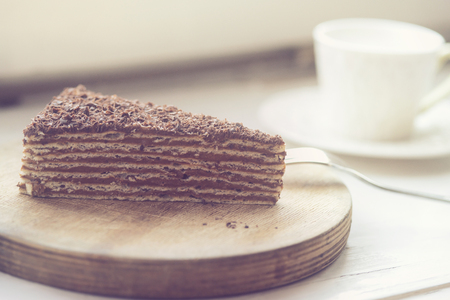 delicious chocolate cake on a wooden stand