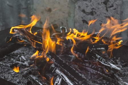 wooden fire on the barbecue.Image as background