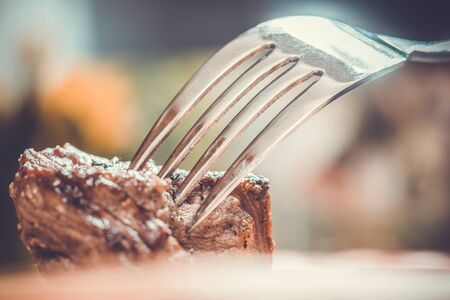 Piece of meat on a fork, food concept Stock Photo