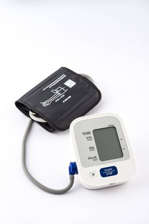 Digital Blood Pressure Monitor on white Фото со стока