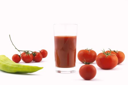 fresh tomato juice , pepper and tomatoes on a white background