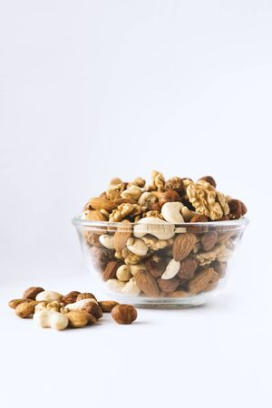 Assorted nuts in a glass bowl. copy space
