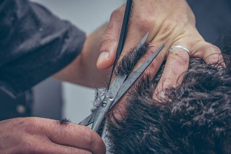 Male client getting haircut by hairdresser Banco de Imagens