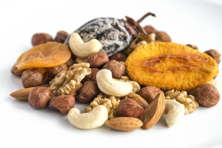 Different kinds of nuts and dry fruits in a plate.